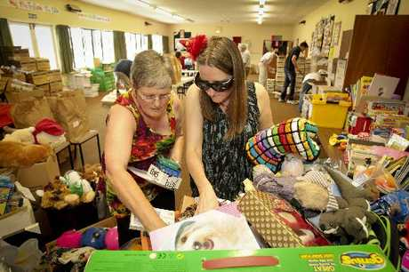Joy Graham (left) and Annette Glover of Hastings get stuck into the boxes of donated goodies, being earmarked for the Hastings cheer parcels this week. Photo / Warren Buckland