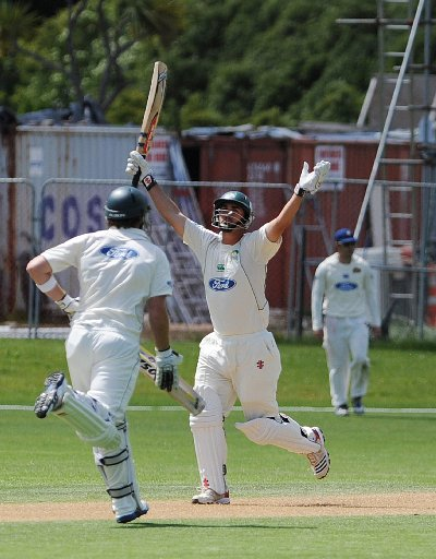 TON TIME: Mathew Sinclair celebrates his 36th career century at University Oval, in Dunedin, yesterday.