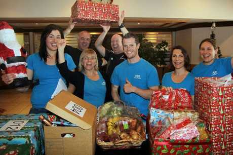 FOR FAMILIES: The team from the Christchurch Methodist Mission and gen-i get into the Christmas spirit as they start collecting more than 200 Christmas hampers carefully put together for the city&#39;s most needy families.