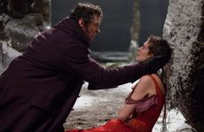 Hugh Jackman and Anne Hathaway in a scene from the movie Les Miserables.