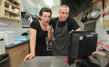 Menus on Main owners Ben and Joyce Hosking re-enact the moment when they saw the CCTV footage of the ghost.