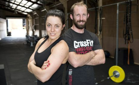 CrossFit Great Divide trainers Christy Cotroneo and Jason Erbacher at Toowoombas Fighting Fit gym this week.