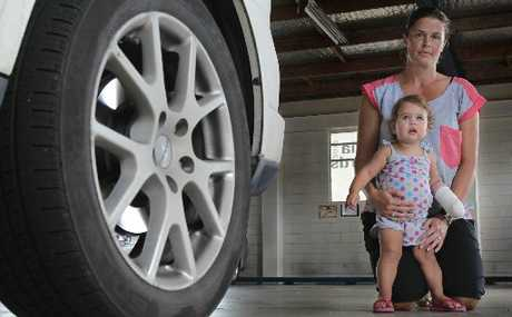 Kirsty Cashmore and 16-month-old Charlize Cashmore who burned her hand badly when her hand slipped through wheel rims on the family car and on to hot brake pads. Photo / John Borren