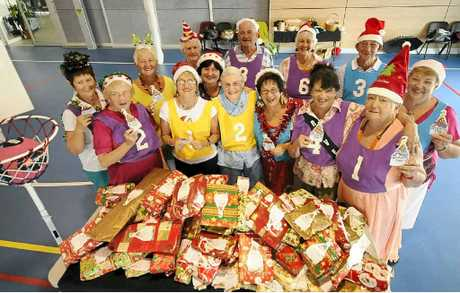 PRESENTATION OF GIFTS: Members of Ballina-Lennox Lifeball collected gifts for the Kmart Wishing Tree appeal.