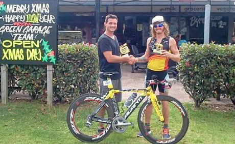 BOOST FOR BEN: Nathan Valentine (left) from the Green Garage and triathlete Ben Ferris.