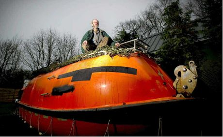 Dutchman Pieter van der Meer with his post-apocalyptic lifeboat which has room for 35 people to survive the predicted global catastrophe.