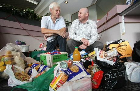 Foodbank chairman Mike Baker and Bay of Plenty Times editor Scott Inglis.