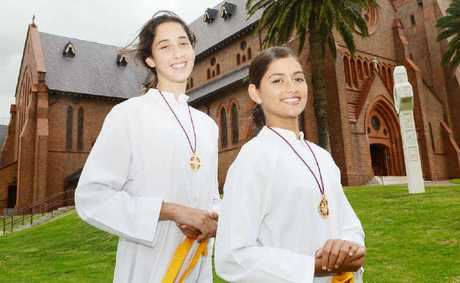 FAITHFUL: Carly Taylor, 13, and her sister Lucy Taylor, 11, of Lismore will be among the altar servers over Christmas at the many catholic churches in the area.