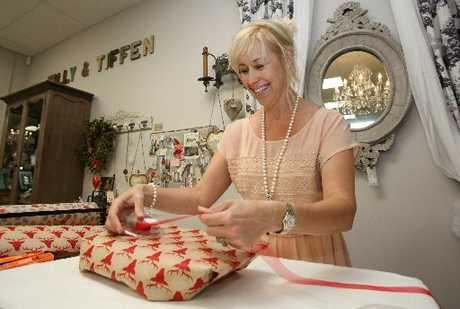 Kim Farrant of Tilly & Tiffen gift shop puts the finishing touches to a Christmas present.