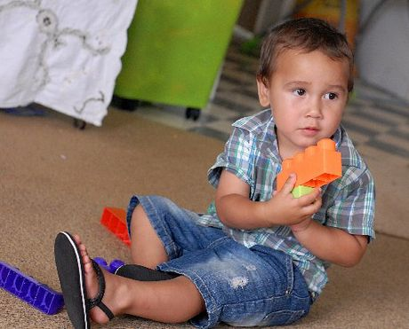 Two-year-old Ozyris Beeching at home in Edgecumbe a year after he was the victim of a horrific dog attack.