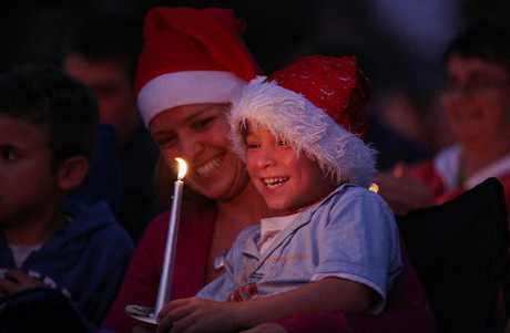 Ben Rikiriki, 6, and his mum Anna celebrate the festive season at the Bethlehem Baptist Church and Bethlehem Town Centre's annual A Night Before Christmas event.