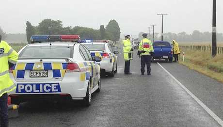 Emergency services at the scene of the crash, on SH2, near Takapau, this morning.