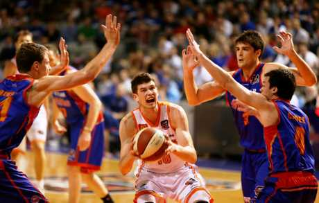 Clint Steindl is surrounded by Adelaide 36rs players.