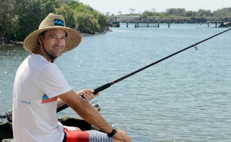 Brisbane boy Josh Murray enjoys a spot of fishing away from the Coolangatta crowds at Jack Evans boat harbour. Photo: Blainey Woodham / Daily News