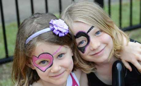 Emily, 5, and Leah, 8, Henderson get into the face painting at Carols on the Grass at the St Stephens Presbyterian Church at South Grafton. Photos: Debrah Novak