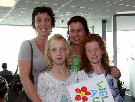 "WELCOME: Debra Stewart (left) with daughters Libby and Kate with ""Aunty Jo"" who arrived from Australia."