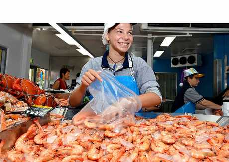 PRAWN SEASON: Tarlie Weller fills up a bag with prawns for customers.