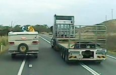 A frame from a video uploaded to Facebook that shows a truckie driving dangerously.