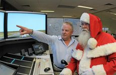 Santa visited the air traffic control simulator at Airservices Learning Academy to see how his flight on Christmas Eve will be managed by air traffic control. (C) Copyright Airservices Australia 2012 Photo credit: