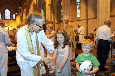 Rev Penny Jones welcomes Sarah and Bryn Cunningham to St Lukes Anglican Church for the Christmas Day service.