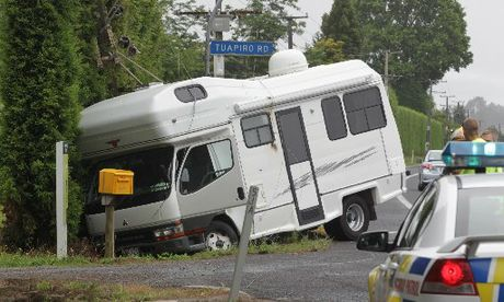 CRASHED: Live power lines were felled when this campervan crashed into a power pole north of Katikati, as the driver attempted to avoid a collision.