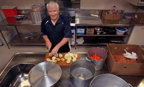 TASTY MOMENT: Volunteer cook Brian Brown chopping up spuds in preparation for St Peter's in the City Community Christmas Dinner.