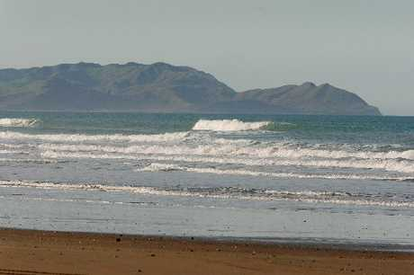 REGULATED: Holidaymakers have been reminded that road safety laws also apply to the beach following an accident at Porangahau Beach (pictured) recently where a 5-year-old girl fell from the back of a ute.
