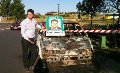 Ballina Greens mayoral candidate jeff Johnson and his campaign van that was stolen on Wednesday night, burnt out and dumped at Pottsville. Photo Contributed