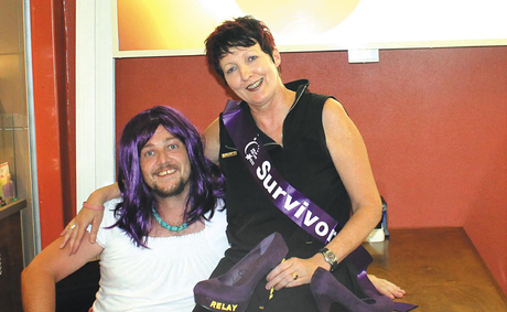 Keryn Bryen pictured with a 'Miss Relay' on the August page of the 2013 Lismore and Villages Relay for Life Calendar.
