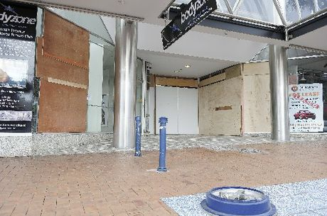 OUT OF CONTROL: The backpaker from Auckland's car bowled through a street bollard and rubbish bin before smashing into a store window and security gate.