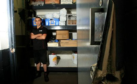 Menniti's seafood was broken into on Christmas morning.Joe Palermo with the break in point at the back door. Photo: Blainey Woodham / Daily News