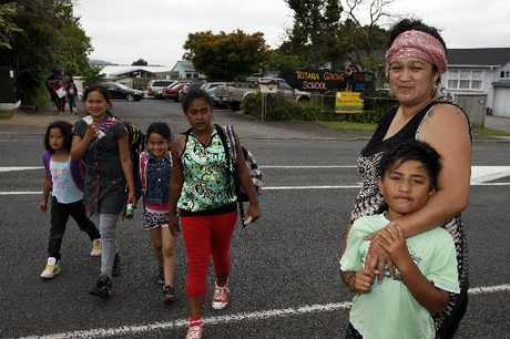 RUNNING THE GAUNTLET: Bridgette Henare (right) with her son Michael, says children risk their lives crossing the road outside Totara Grove Primary School.