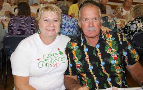 Win and Colin Hick were the picture of Christmas joy at Tuesday's community banquet.
