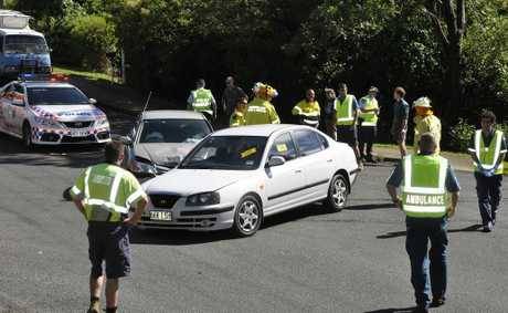 Emergency services attend the scene of a two-car crash at Mt Lofty.