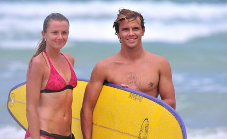 Tennis player Daniela Hantuchova gets surfing lessons from pro surfer Julian Wilson at Coolum Beach.