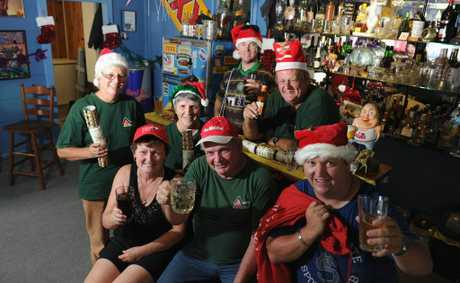 Christmas came late for Takura rural firefighters (back) Peter Murphy, Jack Luchjenbroers, (front) Jill Luchjenbroers, Sarah Murphy, Linda Rangeley, Ken Stanton and James Murphy who were among the numerous crews fighting the Black Swamp Creek fire on Christmas Day and Boxing Day. They are pictured celebrating in Ken Stanton's bar.