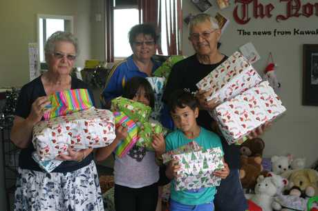 GIFTS: Joan and Tom Petricevich, with daughter Tania and great-grandchildren Remy and Milan - hoping for smiles on Christmas morning.
