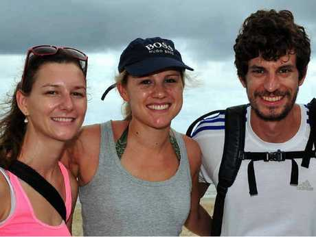 HOLIDAYING BY THE BEACH: International visitors Simone, Leonie and Johannes soak up the sun at Main Beach.