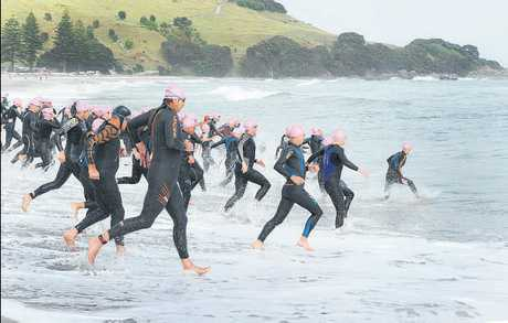 Competitors take off at the start of the surf swim leg.