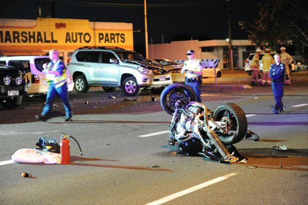 A man died after his motorcycle collided with parked cars on the Dawson Highway near the hockey fields.