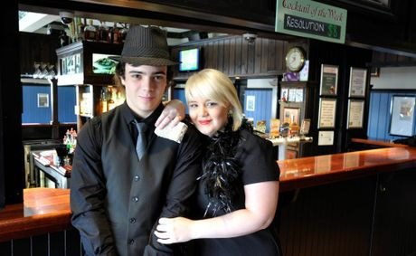 "Irish Club Hotel staff Jeremy Harris (left) and Lisa Schrodter prepare for the ""Black and Bling"" New Year's Eve bash."