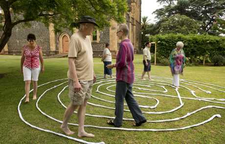 Slowly walking the temporary labyrinth at St Luke's Anglican Church are (front, from left) Kathleen Aisthorpe, Rev Dr Jonathan Inkpin and Rev Penny Jones.