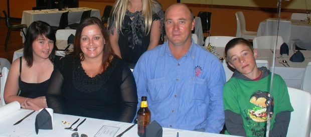 Crash victims (from left) Skye, Sandy, David and Dylan Meehan at the Miles Showgirls dinner last year where their daughter Sharon (not pictured) was a competitor.
