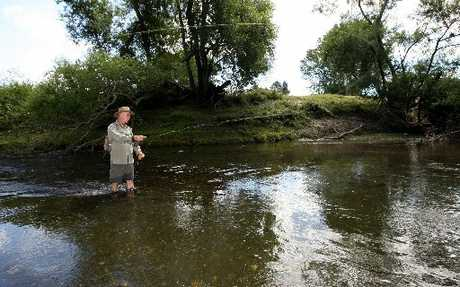"SNAGGED: Fisherman Colin Cook abandoned his fishing on Esk River after discovering a ""green and smelly"" discharge, only to be thwarted in his attempts to report it."