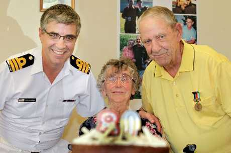 RECOGNITION: Commander Phillip O'Connell presents his parents, Pauline and Morrie, with the New Zealand Defence Service Medal during a celebration of Morrie's 80th birthday.