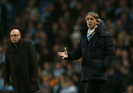Roberto Mancini, manager of Manchester City reacts during the Barclays Premier League match between Manchester City and Reading at Etihad Stadium on December 22, 2012 in Manchester, England.