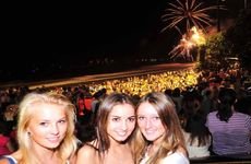 Janna Gollenstedd, Brittany Hook-Davies and Izzy Orton of Buderim watch the New Year fireworks.