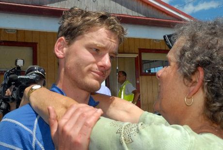 MOTHER'S ARMS: Mountain runner Alastair Shelton hugs his mother Rachel McCahon at the Wairarapa LandSAR base at Hood Aerodrome yesterday after spending two days lost in the cold, windy and rainswept Tararua Ranges.