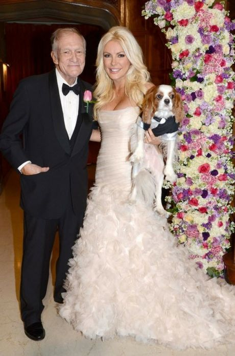 Hugh Hefner and Crystal Harris on their wedding day with their puppy Charlie.
