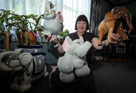 JOHANNA'S JUMBOS: Johanna Lacy is holding two of the most prized of her elephant collection. On the left is a china elephant bought at Auckland Zoo and to the right an elephant from her late mother's collection.